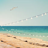 Sea side with party bulbs Stock Images