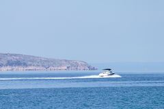 At the sea side - speeding boat Royalty Free Stock Photography