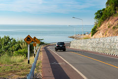 Sea side street near mountain with blue sky in clear day in Chan Royalty Free Stock Images