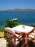 Sea side taverna in Crete. Romantic sea side taverna in Elounda, small city of Crete stock image