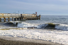 Sea Side Waves and Pier Royalty Free Stock Photos
