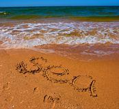 Sea sign on a sand Royalty Free Stock Photo