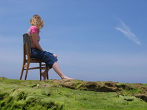 Sea Sit. Woman sitting on old chair by the sea Royalty Free Stock Photos