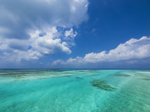 Sea and sky. Tropical aquamarine sea and clouds in paradise Royalty Free Stock Image