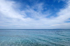 Sea and sky. The blue sea and the cloudy sky Royalty Free Stock Photos