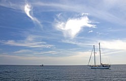 Sea, sky, & boat. Bright day for yacthing in Thailand royalty free stock photo