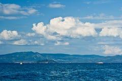 Sea, sky, clouds and ship. Beautiful blue sea with small ship. Sky and light clouds. Greece, Halkidiki, Kassandra royalty free stock photos