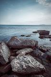 Sea sky and huge stones Stock Photography