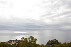 Sea and sky merge on the coast of Blanes. Sea and sky merge at the foot of the Castle of St. John in Blanes royalty free stock photos