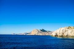 Sea sky and mountains. Blue sea sky and mountains near Lindos Rhodes island, Greece royalty free stock image