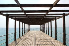 Sea, sky, pier, summer, blue, water, Black sea, lines. The view of the black sea from the pier, the sea is calm, no wind. A quiet morning on the shore of the sea Royalty Free Stock Photos