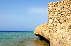 Sea, sky and rock. Sea, sky and a stone wall on a rock Royalty Free Stock Photography