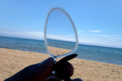Sea, sky and sand view through glasses distortion Royalty Free Stock Photography