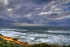 The sea and sky after storm. Cliffs Royalty Free Stock Image
