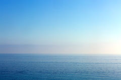 Sea and Sky. A vast blue backdrop of sea and sky royalty free stock images