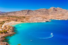 Sea skyview landscape photo of Agia Agathi beach near Feraklos castle on Rhodes island, Dodecanese, Greece. Panorama with sand. Beach and clear blue water royalty free stock photography