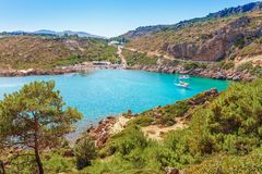 Sea skyview landscape photo Ladiko bay near Anthony Quinn bay on Rhodes island, Dodecanese, Greece. Panorama with nice sand beach. And clear blue water. Famous royalty free stock images