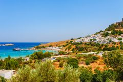 Sea skyview landscape photo Lindos bay and castle on Rhodes island, Dodecanese, Greece. Panorama with ancient castle and clear. Blue water. Famous tourist royalty free stock images