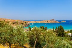 Sea skyview landscape photo Lindos bay and castle on Rhodes island, Dodecanese, Greece. Panorama with ancient castle and clear. Blue water. Famous tourist stock images