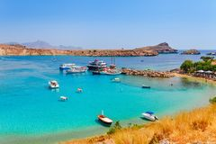 Sea skyview landscape photo Lindos bay and sea coast on Rhodes island, Dodecanese, Greece. Panorama with nice sand beach and clear. Blue water. Famous tourist royalty free stock photography