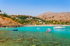 Sea skyview landscape photo Lindos bay and sea coast on Rhodes island, Dodecanese, Greece. Panorama with nice sand beach and clear. Blue water. Famous tourist royalty free stock image