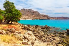 Sea skyview landscape photo near Agia Agathi beach and Feraklos castle on Rhodes island, Dodecanese, Greece. Panorama with sand stock photography