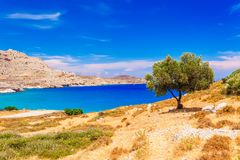 Sea skyview landscape photo near Agia Agathi beach and Feraklos castle on Rhodes island, Dodecanese, Greece. Panorama with sand stock images