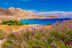 Sea skyview landscape photo near Agia Agathi beach and Feraklos castle on Rhodes island, Dodecanese, Greece. Panorama with sand stock photo