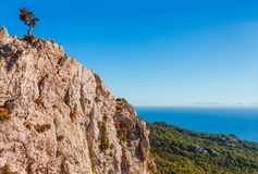Sea skyview landscape photo from ruins of Monolithos castle on Rhodes island, Dodecanese, Greece. Panorama with green mountains stock photo