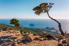Sea skyview landscape photo from ruins of Monolithos castle on Rhodes island, Dodecanese, Greece. Panorama with green mountains royalty free stock photo
