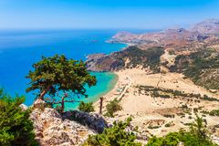 Sea skyview landscape photo Tsambika bay on Rhodes island, Dodecanese, Greece. Panorama with nice sand beach and clear blue water. Famous tourist destination stock images