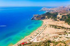 Sea skyview landscape photo Tsambika bay on Rhodes island, Dodecanese, Greece. Panorama with nice sand beach and clear blue water. Famous tourist destination stock photos