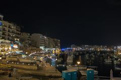 The sea in Sliema in a summer day. SLIEMA, MALTA - AUGUST 05, 2018: a port with many small boats and buildings at night in Sliema, Malta Stock Photo