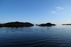The sea with small islands in Norge Royalty Free Stock Photo