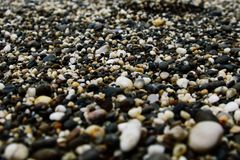 Sea small stones on the seashore royalty free stock photo