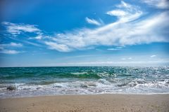 On sea small waves of. Blue sky with clouds stock photos