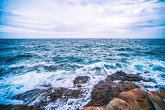 Sea with Smooth Wave and Rock landscape. Nature of Seascape in vacation holiday travel relax time