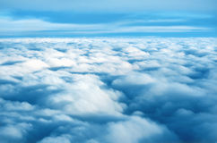 Sea of soft fluffy clouds. High above a sea of soft fluffy clouds extending into the horizon royalty free stock photography