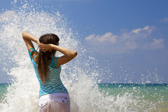 In the sea splashes stock photos