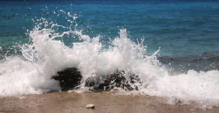 Sea splashes. Sunny beautiful energy sea splashes stock photography