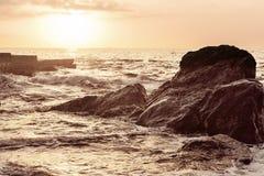 Sea splashing on rocks Stock Photography