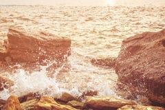 Sea splashing on rocks Royalty Free Stock Photo
