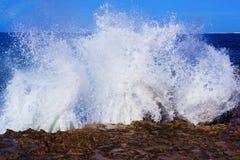 Sea splashing on rocks Royalty Free Stock Images