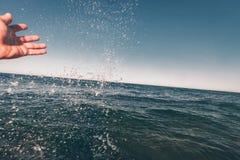 Sea spray bathing. On vacation royalty free stock image