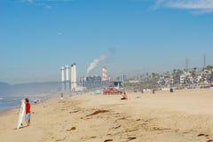 Sea spray and fog with industrial smog shrouds Californian beach Royalty Free Stock Photos