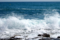 Sea spray frozen in action. Sea spray as viewed from cala blanca Stock Photography