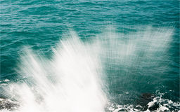 Sea spray. Sea waves breaking on the rocks Stock Photos