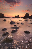 Sea stacks at Ballintoy Harbour, Northern Ireland at sunset stock photo