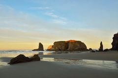 Sea stacks on Bandon beach at sunrise, Oregon Stock Photography