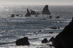 Sea Stacks and Northern California Coast. The rugged coast of northern California is shaped by endless waves and wind coming from the Pacific Ocean. This Royalty Free Stock Photo